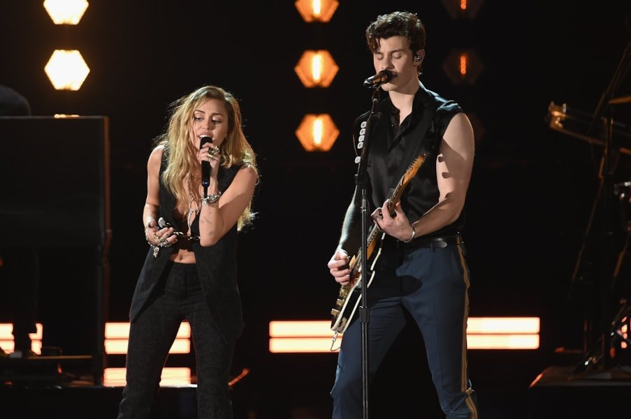 LOS ANGELES, CA - FEBRUARY 10:  Miley Cyrus (L) and Shawn Mendes perform onstage during the 61st Annual GRAMMY Awards at Staples Center on February 10, 2019 in Los Angeles, California.  (Photo by Kevin Winter/Getty Images for The Recording Academy)
